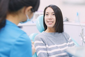 Woman discussing the smile design process with her cosmetic dentist